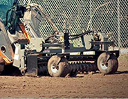 SitePro power landscape rake attachment for grading new and existing construction sites.